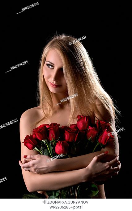 Nice topless girl posing with bouquet of red roses