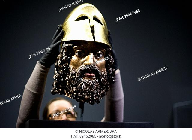 The so-called Riace Head (a reconstrcution of Warrior A of the Riace bronzes) receives a gilded helmet at the exhibition 'Back to the Classics