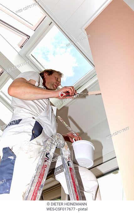Europe, Germany, Rhineland Palatinate, Man painting interior of chimney