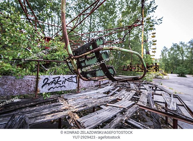 Roundabout in amusement park in Pripyat ghost city of Chernobyl Nuclear Power Plant Zone of Alienation around nuclear reactor disaster in Ukraine