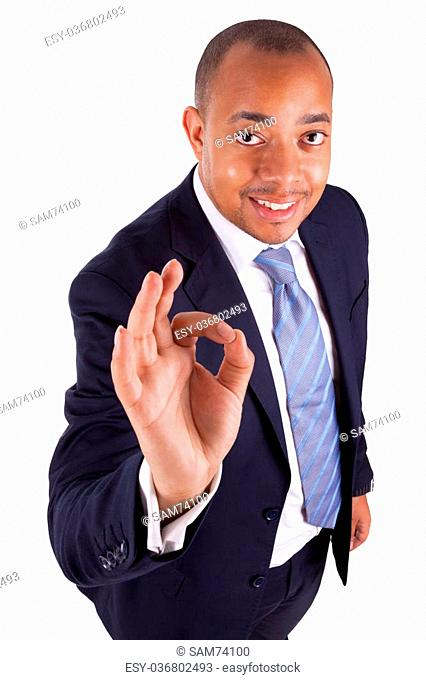 c407219525 African American business man making ok gesture with the hand, isolated on  white background -