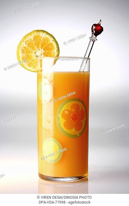 Drinks , Orange juice with an orange slice and stirrer on white background