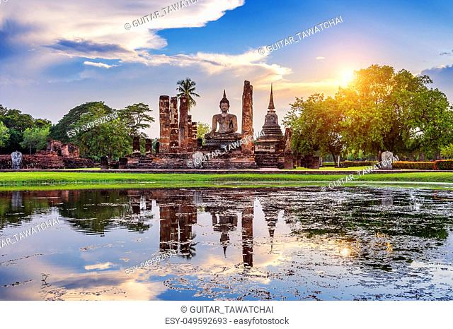 Buddha statue and Wat Mahathat Temple in the precinct of Sukhothai Historical Park, Wat Mahathat Temple is UNESCO World Heritage Site, Thailand