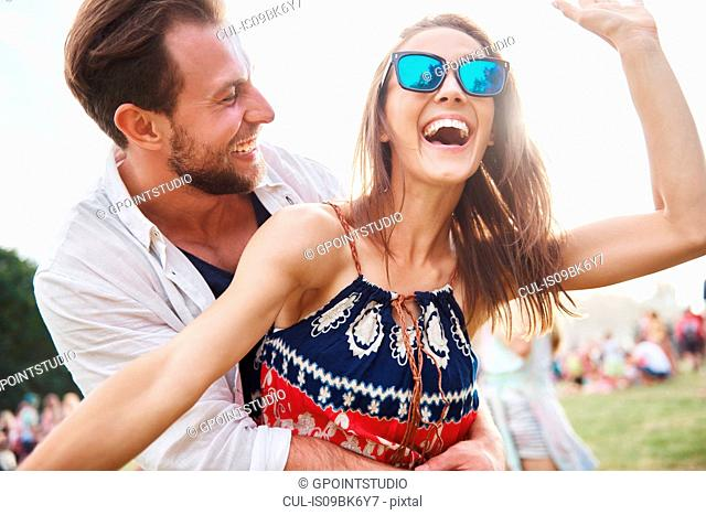 Couple laughing and enjoying music festival