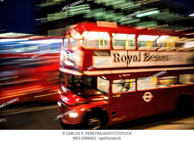 London's iconic bus at night, London, UK