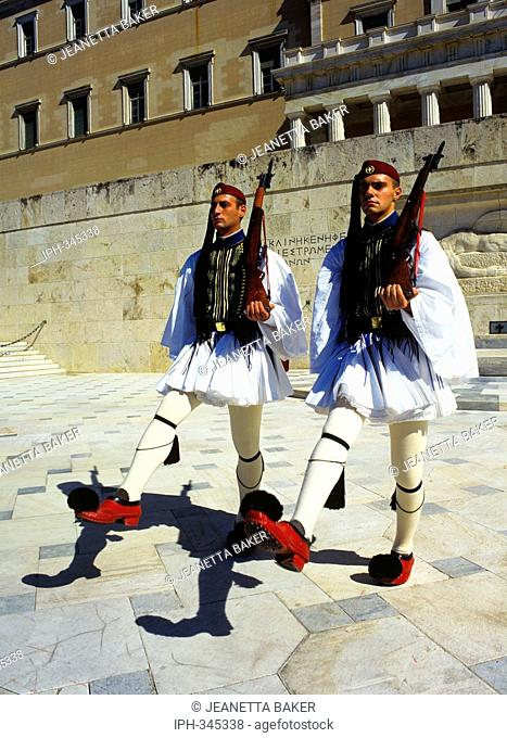 Athens - Evzone guards at the Tomb of the Unknown Soldier in front of the Greek Parliament Building