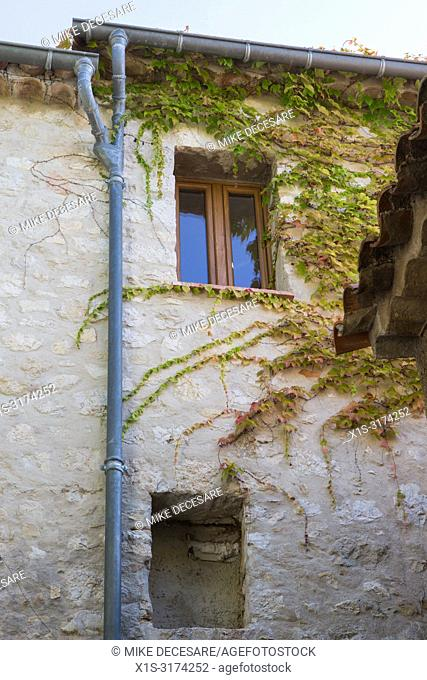 Vines add color and life to an ancient stone building in the French village of Eze