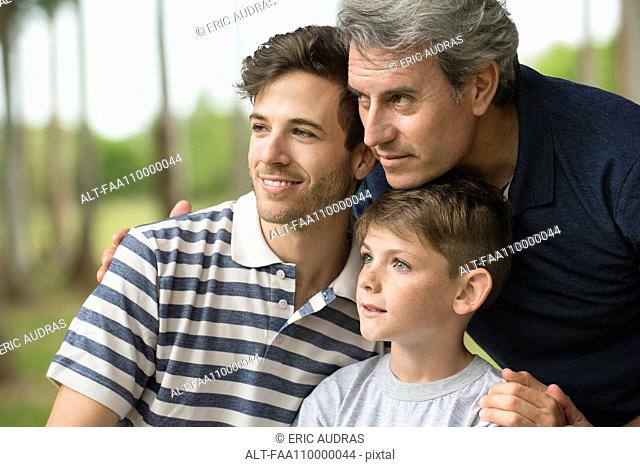 Mature man with son and grandson, portrait