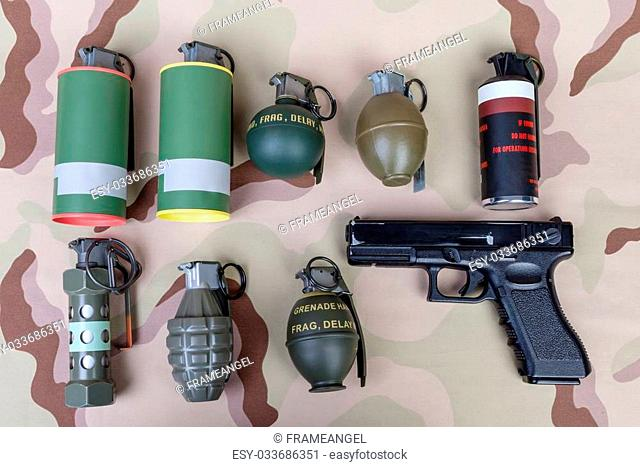 All explosives, weapon army,standard time fuze, hand grenade and gun on camouflage background, top view