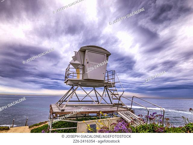 Majestic storm clouds over the ocean with a lifeguard tower in the foreground. La Jolla, California, United States