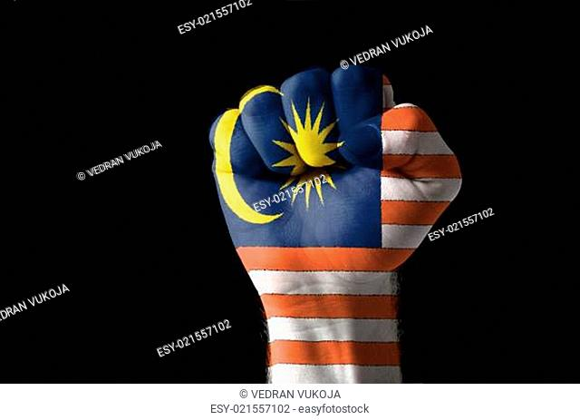 Fist painted in colors of malaysia flag