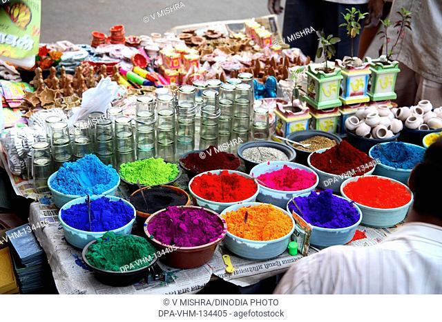 Deepawali Diwali festival  ; sale of decorative items clay oil lamps rangoli colors etc. on road ; Mumbai Bombay ; Maharashtra ; India