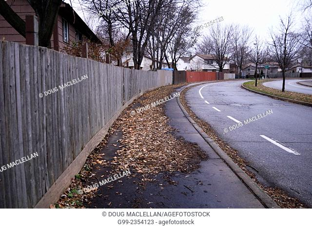 Residential scene of fencing and street in Little River Acres, an east end community in Windsor, Ontario, Canada. The fencing which looks like it should be for...
