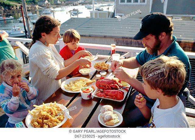Family dinning. Maine. USA