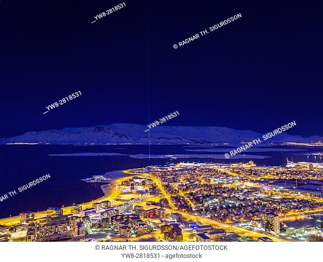 Winter, Reykjavik, Iceland. Imagine Peace Tower light and Mt Esja in the background. Drone Photography