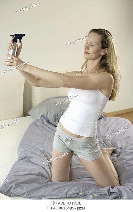 An ecstatic blonde woman spraying