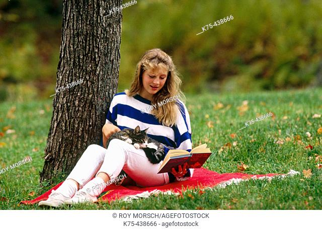 Reading with her cat on lap