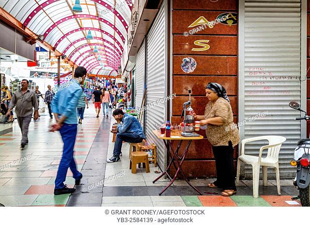 A Local Woman Squeezing Pomegranate Juice In The Grand Bazaar, Marmaris, Mugla Province, Turkey