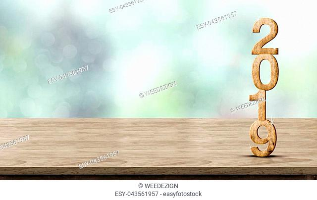 New year 2019 wood number (3d rendering) on wooden table at blur abstract green bokeh background,Mock up banner space for display or montage of product