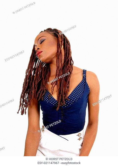 A beautiful young African American woman with long braided brown hair,.tilting her head sideward, isolated for white background.