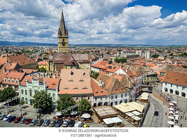 Aerial view from Council Tower with Hermes House (green building) and bell tower of Lutheran Saint Mary Cathedral, Historic Center of Sibiu, Romania