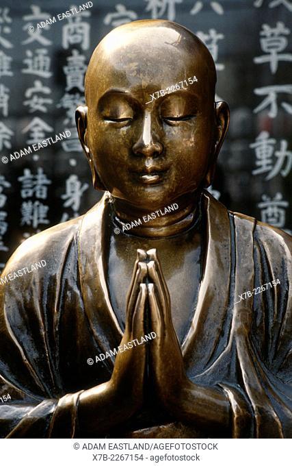 Tokyo. Japan. Bronze Buddha statue outside the Kannon Temple in the Senso ji Buddhist temple complex in Asakusa