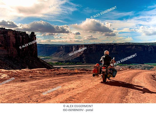 Biker on rock climbing route, Canyonlands National Park, Moab, Utah, USA