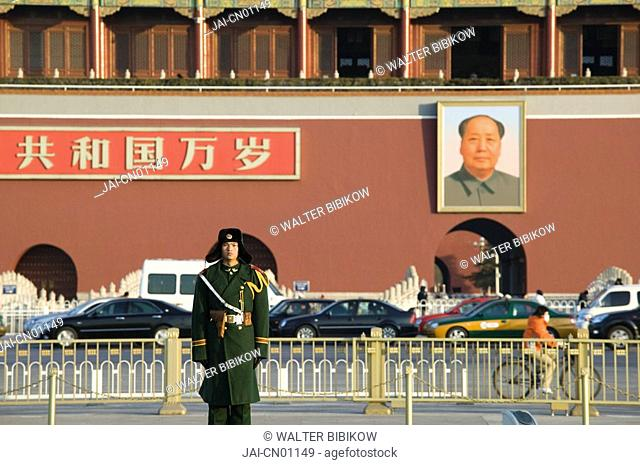 China, Beijing, Tiananmen Square, Policeman in winter clothes across from the Gate of Heavenly Peace, entrance to the Forbidden City