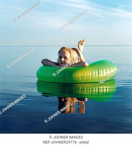 Girl floating on inflatable raft