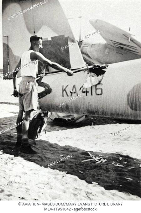 Man Using an Axe on a Royal Air Force RAF de Havilland Dh-98 Mosquito Fb-26 Being Scrapped