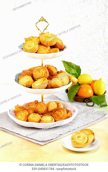 Spirals of fried pastry flavored with orange, typical Italian sweets made during the carnival period
