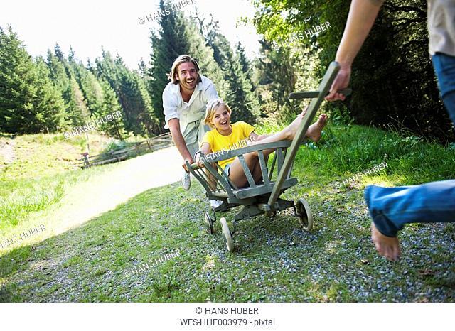 Austria, Salzburg County , Family with rack wagon
