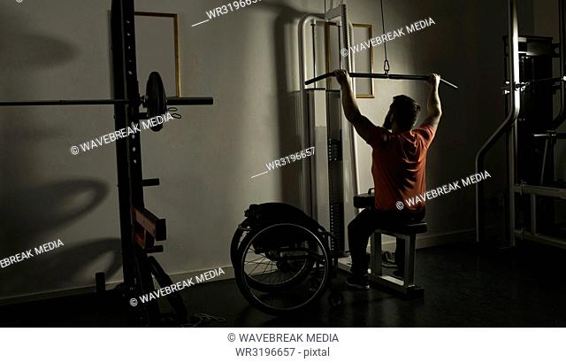 Handicapped man working out lat pulldown training