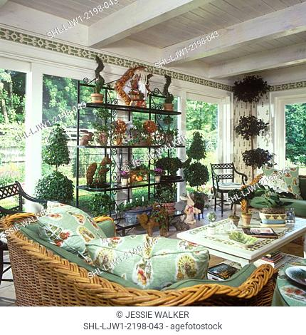 SOLARIUM - Sunroom with topiary, Bakers Rack. Wicker settee, beamed ceiling, iron garden furniture, animal topiary, green