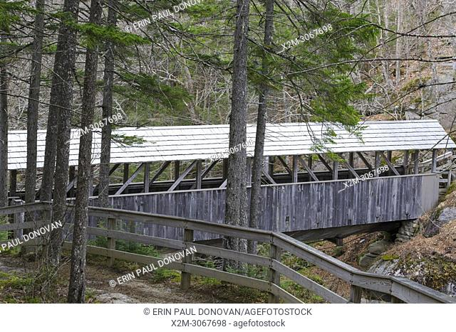 Sentinel Pine Covered Bridge in Lincoln, New Hampshire during the spring months. This footbridge is within Franconia Notch State Park and crosses over the...