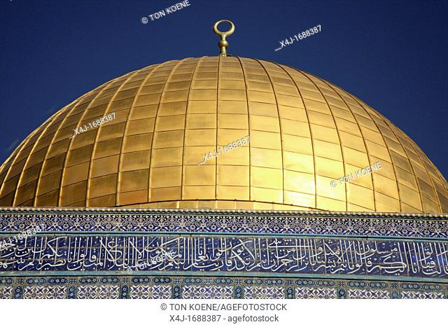 A closeup of the golden dome atop the Dome of the Rock on Temple Mount in the Old City of Jerusalem