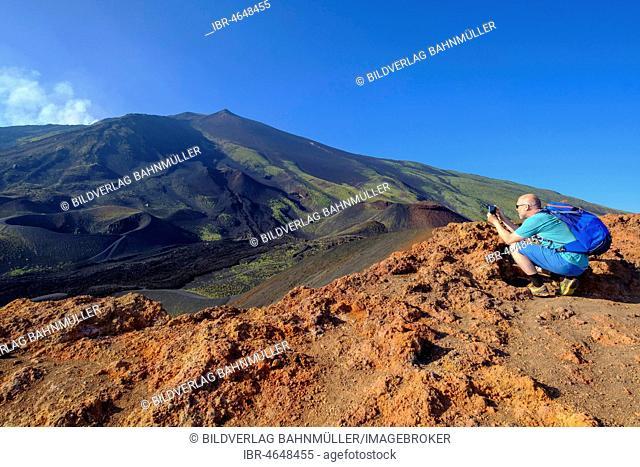 Tourist photographing, Volcanic landscape, Volcano Etna, Province of Catania, Silzilia, Italy