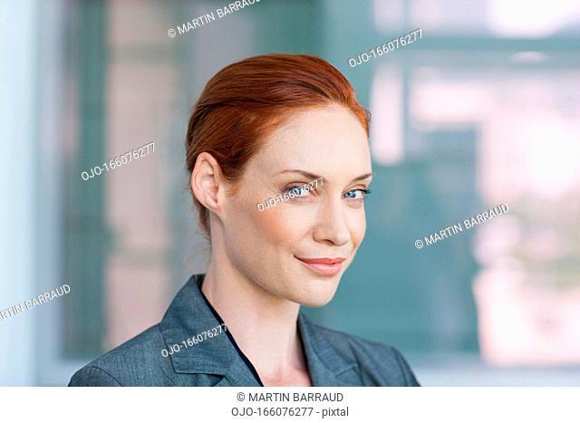Close up portrait of smiling businesswoman
