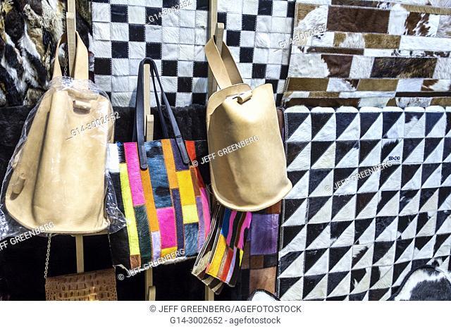 Argentina, Buenos Aires, San Telmo, Pasaje Galeria de la Defensa, shopping, rugs, patchwork, women's handbags, leather goods, Hispanic