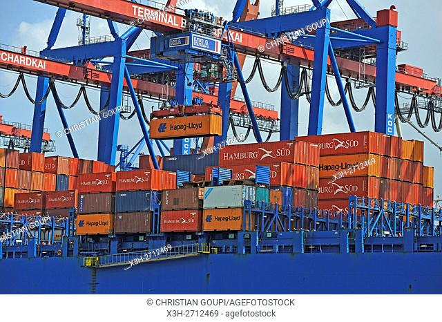 loading on container-ship in the port of Hamburg, Germany, Europe