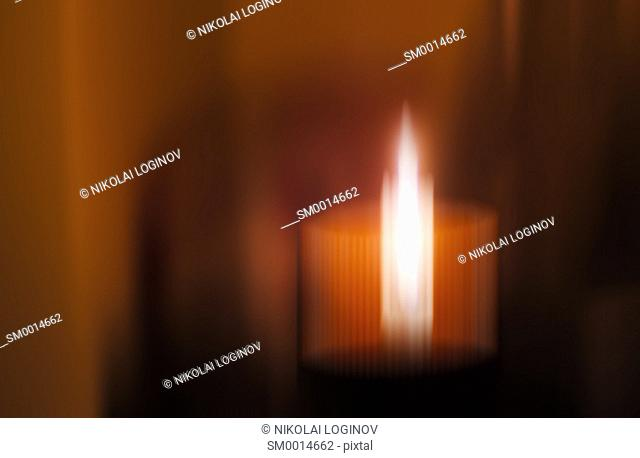 Horizontal vivid blurred candle abstraction background backdrop