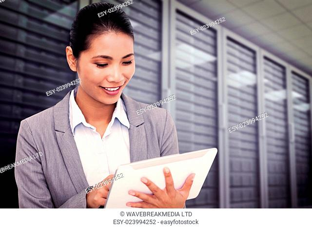 Close up of a laughing customer service agent using headset against server room