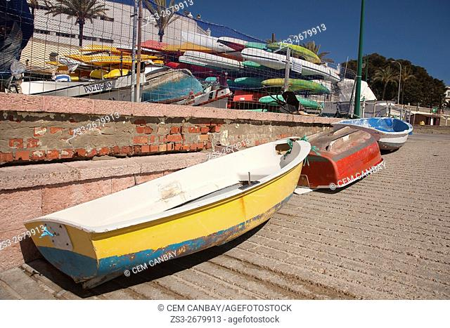 Colorful fishing boats and surf boards at the Caleta beach, Andalusia, Spain, Europe