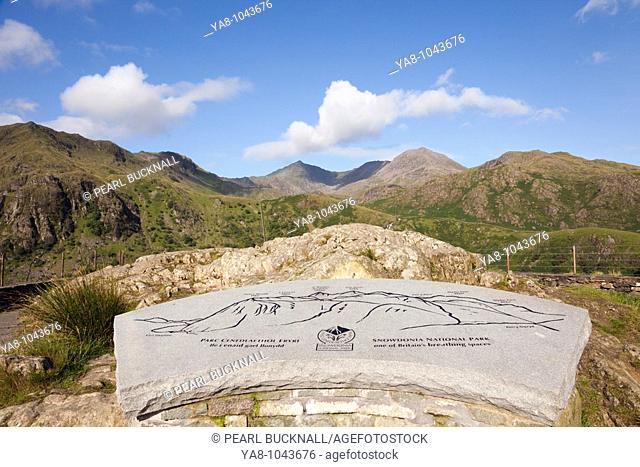 Pen-y-Pass Gwynedd North Wales UK  August Tourist Information pictorial stone plaque showing mountains at Snowdon horseshoe viewpoint in Nant Gwynant in winter...