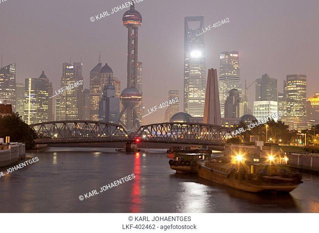 View of Huangpu River with Waibaidu bridge and Pudong skyline at night, Shanghai, China, Asia