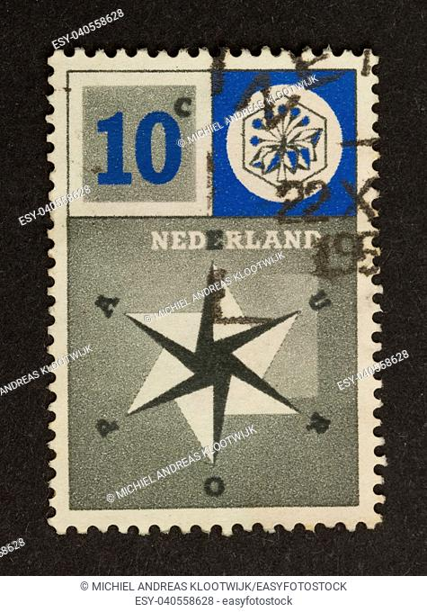 HOLLAND - CIRCA 1950: Stamp printed in the Netherlands shows a star, circa 1950