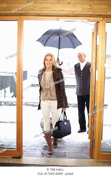 Couple walking through hotel front doors