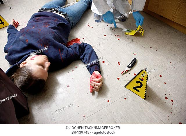 Securing forensic evidence at a crime scene after a capital offence, homicide, by the C.I.D., the Criminal Investigation Department, re-enacted scene
