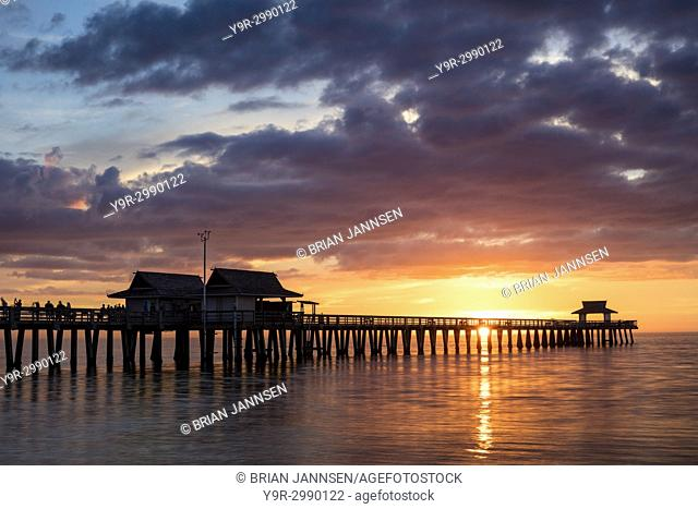 Colorful sunset over the Naples Pier, Naples, Florida, USA