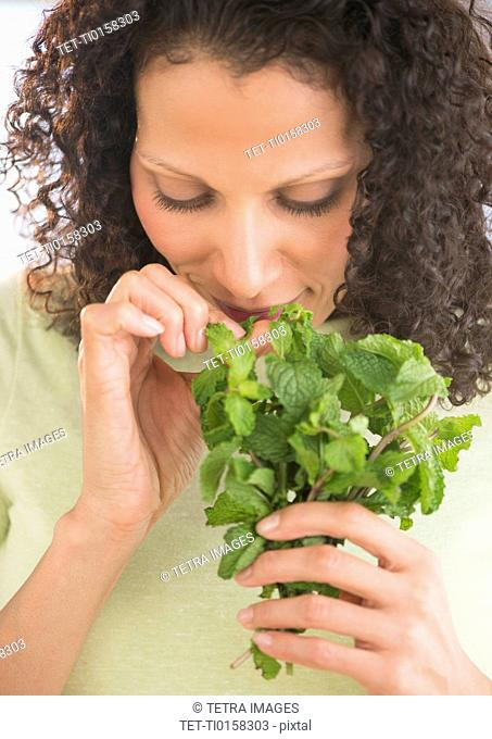 Woman smelling fresh mint